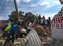 Migrantes se unen a la ayuda de damnificados por el sismo